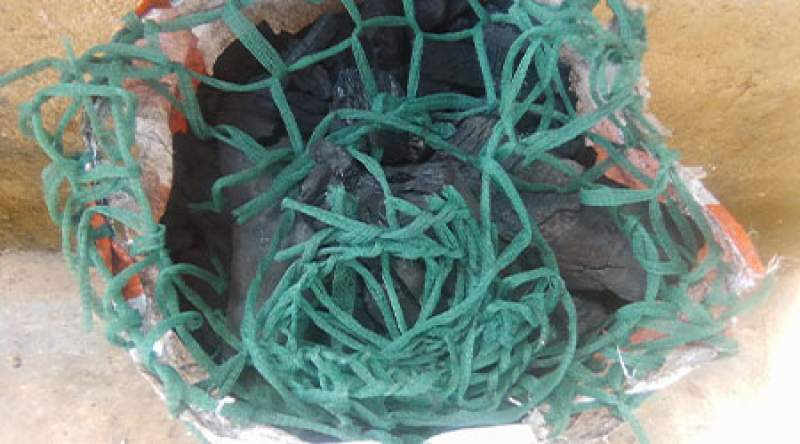 A bag of charcoal with bed net strings amid a rise in malarial cases in Neno